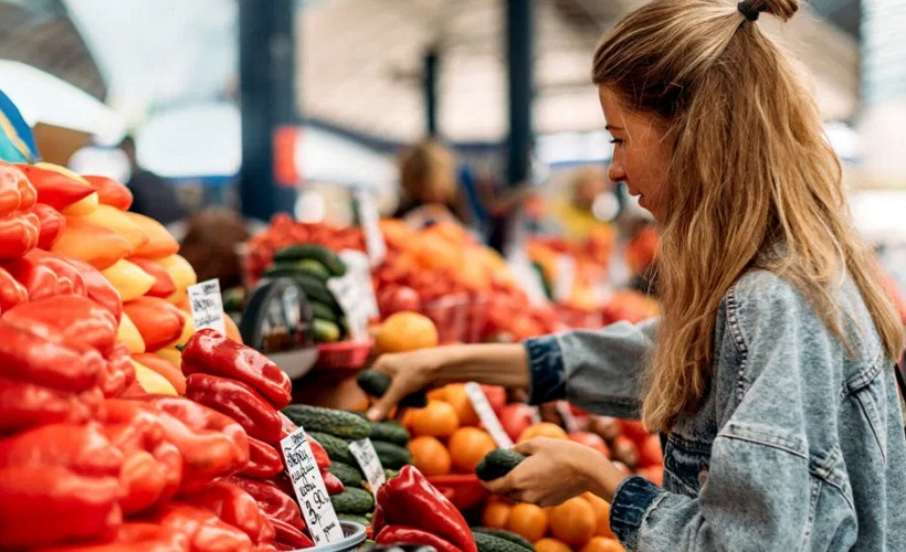 Woman shopping in produce section of a supermarket