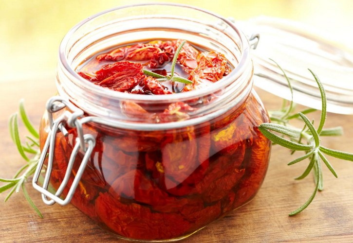 Sun dried tomatoes soaked in oil inside a glass jar
