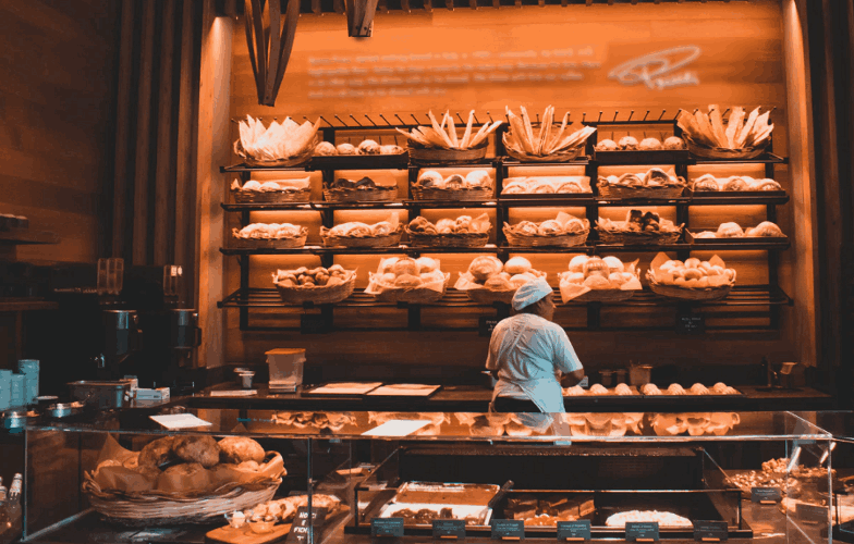 A Baker standing in the Bakery section of the grocery store