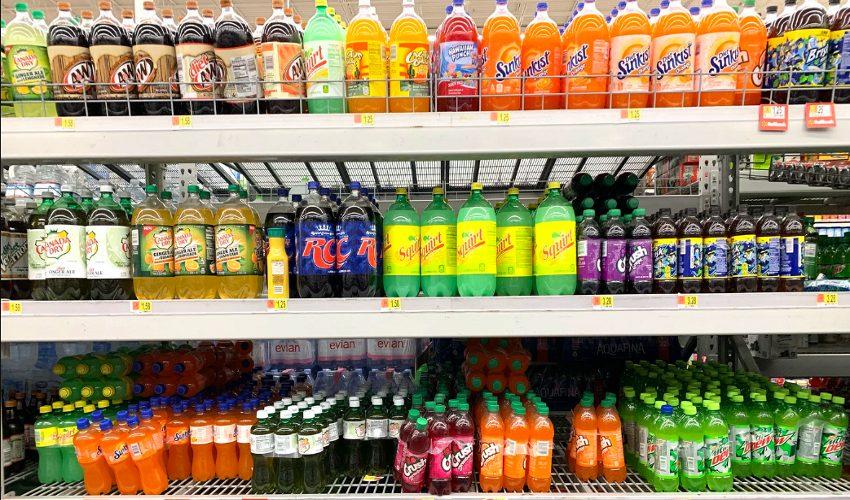 Beverage aisle shelf containing soft drinks