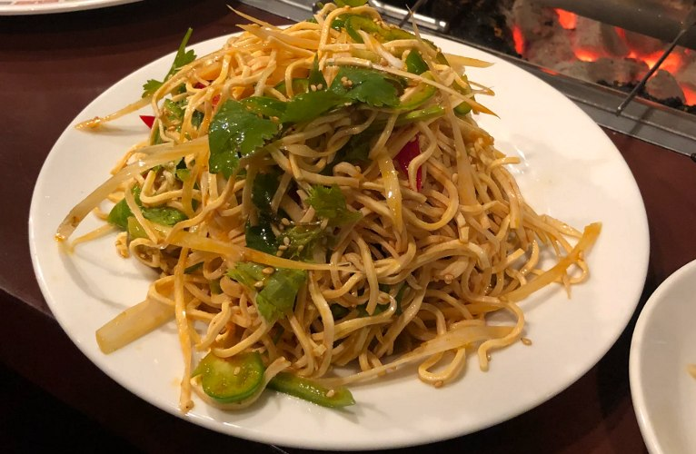 Cooked bean sprouts on a white plate