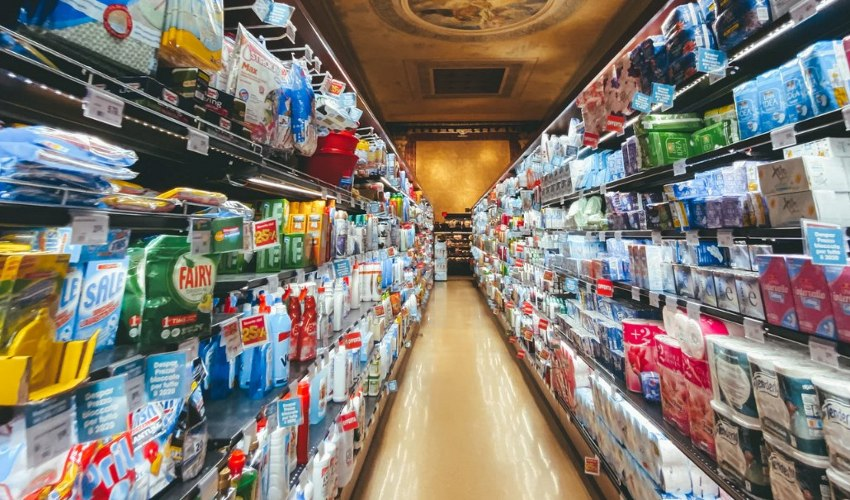 Paper products and Cleaning supplies aisle in grocery store