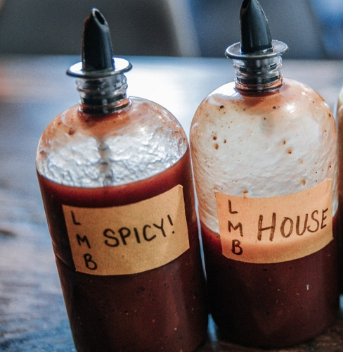 Two bottles of spicy barbecue sauce