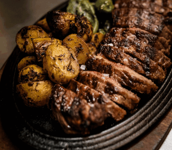 Steak dish with roasted potatoes on the side