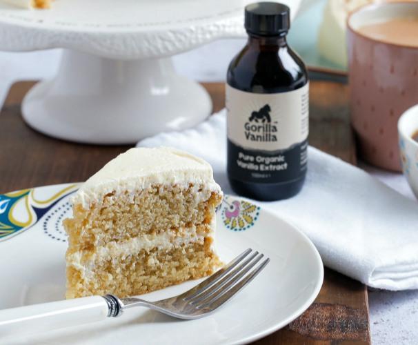 Bottled Gorilla Vanilla Extract beside cake on a white plate