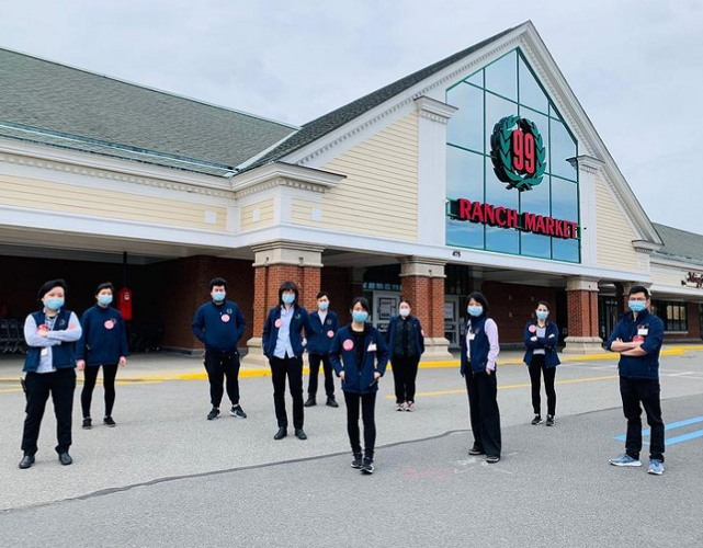 Employees standing in front of 99 Ranch Market grocery store