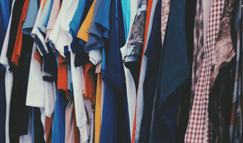 Assorted apparels on hangers in clothing store