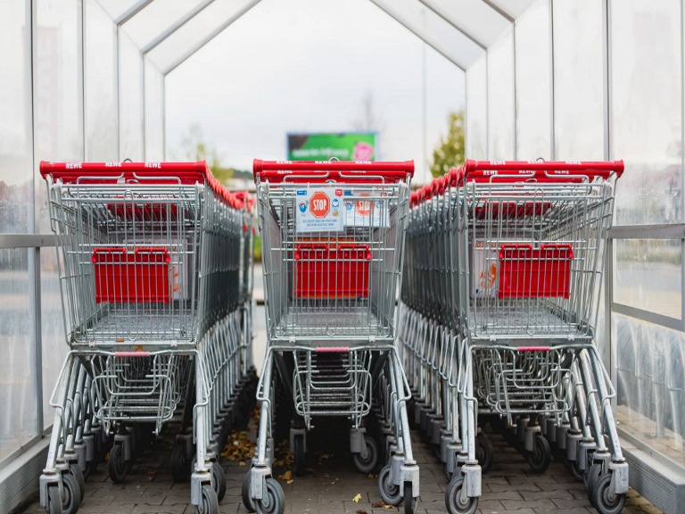 Kroger vs Meijer header image containing three rows of shopping carts