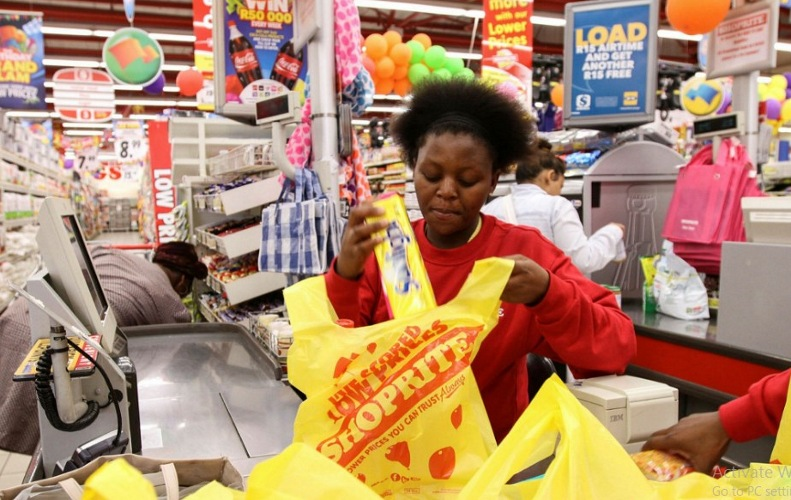 Shoprite cashier checking out customer purchased items