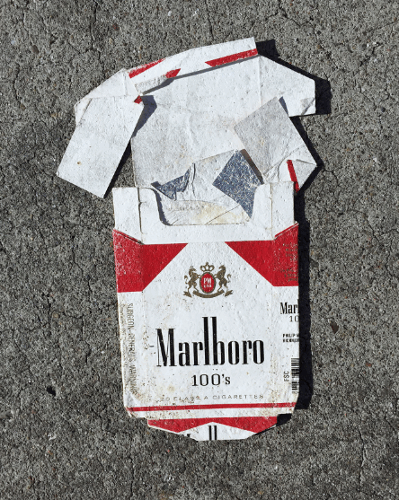 Squashed Marlboro cigarette pack on the floor