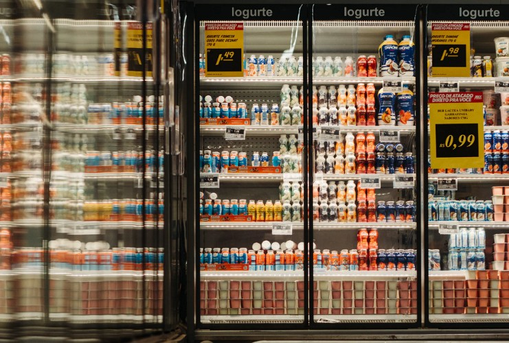 Refrigerator section in a grocery store containing dairy products