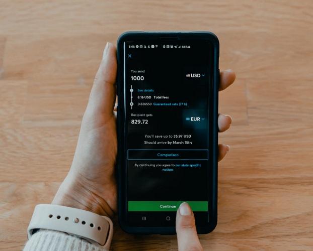 Person sending money through an app